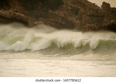 Surfing in the beach of Biarritz