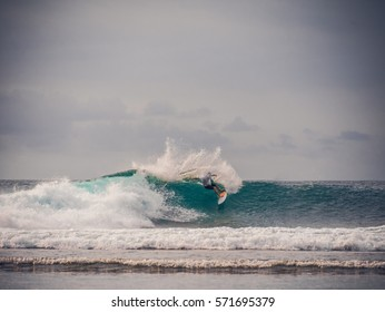 Surfing the big wave / Bali surfer with skill