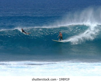 Surfing a big wave on Maui's north shore