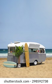 Surfing fast food truck, old caravan on the beach, vertical template with copy space