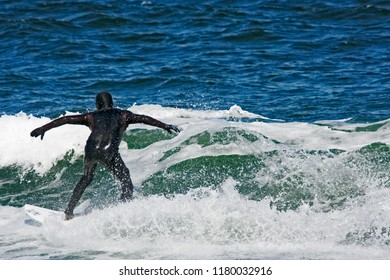The surfer thrashing