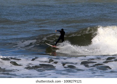 Surfing - riding on a wave on special light boards.