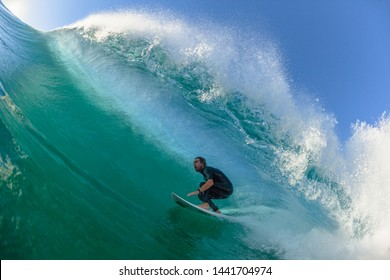 Surfing Water Action- Ballito Bay, KZ Natal / South-Africa - July 2 - 2019: Surfing surfer Michael Dunphy tube from Florida USA rides hollow ocean wave closeup swimming action sequence of photos.