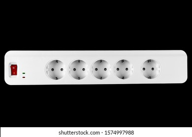 The surge protector isolated on black background. Closeup of electrical power strip on black background. Power surge isolated. Household surge protector