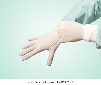 surgeon doctor wear glove before operation