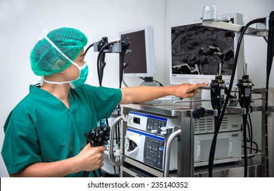 The surgeon looks at the monitor during surgical operation