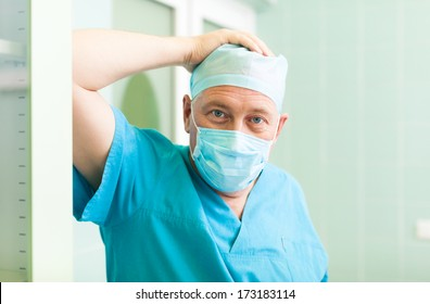 2e7c0451488 surgeon man relaxed smile confident in surgical room hospital, medical  doctor wear green surgery scrub