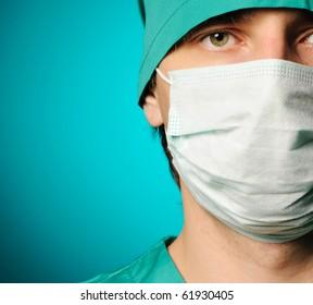 Surgeon in mask close-up portrait