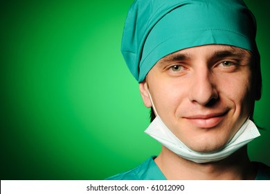 Surgeon with mask over green