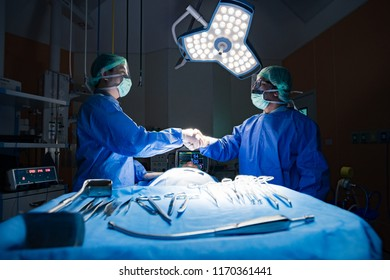 Surgeon performing operation in operating room