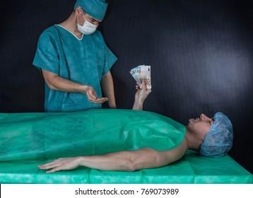 Surgeon receives money from patient. Black background.
