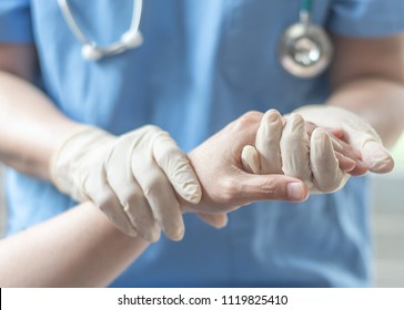 Surgeon, surgical doctor, anesthetist or anesthesiologist holding patient's hand for health care trust and support in professional surgical operation, medical anesthetic safety, ER healthcare concept