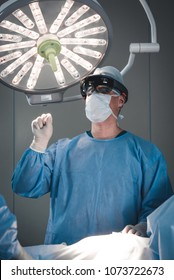 Surgeon using augmented reality holographic hololens glasses while operating in modern operation theater