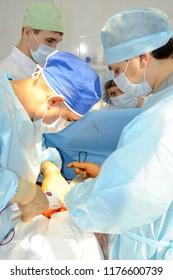 Surgeons do the operation.