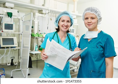 surgeons in uniform in operation or reanimation room at cardiac surgery clinic