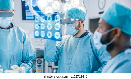 Surgeons Wearing Augmented Reality Glasses Perform State of the Art Augmented Reality Surgery in High Tech Hospital. Surgeon Looks at Brain Scans and Medical History of the Patient.