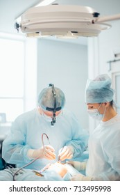 Surgery team operating nose in a surgical room