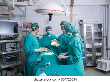Surgery team operating in a surgical room