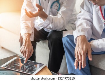 Surgical doctor teamwork, ER surgery team, orthopedic surgeon discussion work on digital tablet in hospital medical clinic meeting room diagnostic exam on patient care operation professional service
