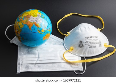 Surgical Face Mask and Globe model. Coronavirus Concept. Medical Face Mask For Stopping The Spread of Flu Virus. Surgical mask with rubber ear straps. Standard surgical mask to cover the mouth and nos - Shutterstock ID 1659972121