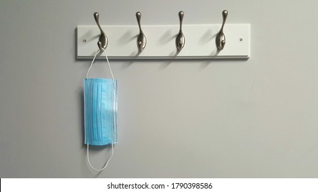 Surgical face mask hanging on hook