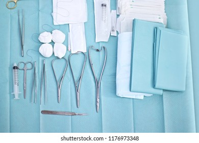 Surgical instruments and tools including scalpels, forceps and tweezers arranged on blue background top view. Medical and surgery concept. - Shutterstock ID 1176973348