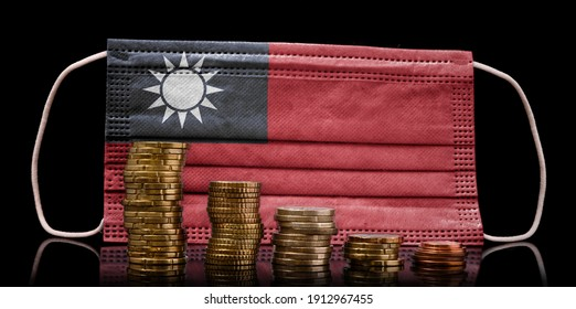 A surgical mask with the flag of Taiwan behind some descending stacks of various coins.(series)