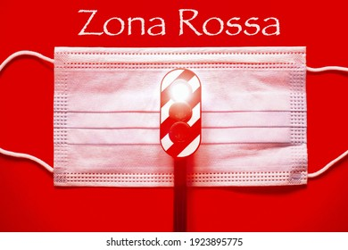 "Surgical mask with a traffic light with a red light with the text ""Zona Rossa"" translating in italian ""Red zone"" concept of red zone during Corona Virus"