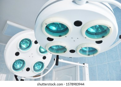 Surgical, operating lamp. Surgical lamps in operation hospital room.