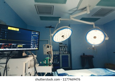 Surgical operating room with equipment for cardiovascular emergency surgery center. Surgery medical clinic with clamps, forceps and injection syringe and surgeons for open heart microsurgery