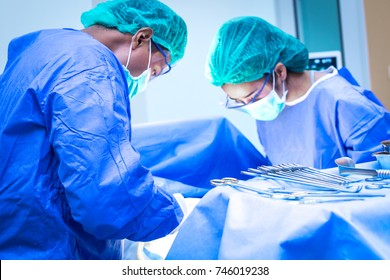 Surgical team performing surgery operation. Doctor performing surgery .