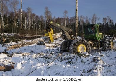 Surgut, Khanty-Mansi Autonomous Okrug / Russia - 01.31.2015: Mechanized felling clearing. John Deere 748H skidder at work.