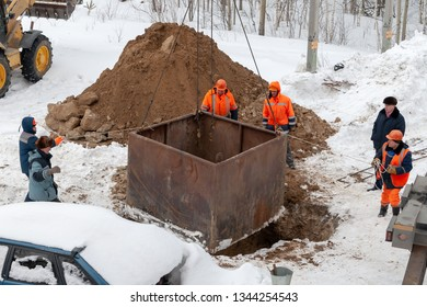 Surgut, Russia, 03.18.2019: Elimination of the accident of underground utilities. The emergency service team of municipal services are working on the elimination of the pipeline accident.