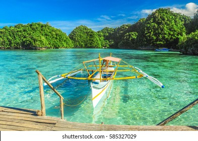Surigao,Philippines-May 27,2012 : A man is preparing his boat for passengers to ride for the next trip.