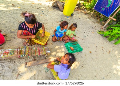 Surin Islands, Phang Nga, Thailand - January 3, 2016: top view of Sea Gypsies family selling necklaces and bracelets in Moken tribe, fisherman village of Ko Surin Marine National Park.