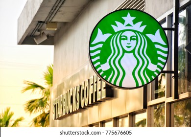 Surin,  Thailand - 14 December 2017 : Starbucks Coffee logo at Robinson Surin with warm light.