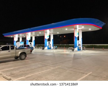 Surin, Thailand - Apr 16, 2019 :  PTT Gas Station for Customer at night.People are less in gas station at night time.Calm pump.