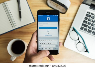 SURIN, THAILAND - Apr 26, 2018: Facebook social media app logo on log-in, sign-up registration page on mobile app screen on iPhone 7 Plus smart devices in business person's hand