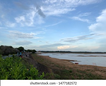 Surin, Thailand - Aug 12, 2019 : Very little water in lake in the evening at Surin. Natural calamity. Little water in river.Brown soil and little aqua and white cloud on sky background.Dry season.