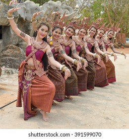 SURIN THAILAND - MARCH 12, 2016: Dance Thailand or Cambodia Kuy before opening reception and feeding the elephants and elephant riding and leisure passengers walk in Surin, Thailand. on 12 March 2016.