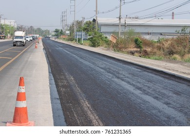 SURIN, THAILAND - MARCH 6, 2015: Road construction in Thailand. Photo at road no 214 on MARCH 6, 2015.