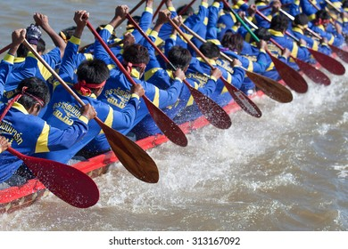 SURIN THAILAND-AUG-20: Unidentified rowers in Climbing Bows toward Snatching a Flag native Thai long boats compete during Native Long Boat Race Championship on AUG 20, 2015 in SURIN, Thailand.