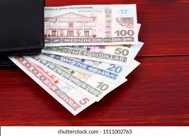 Surinamese Dollar in the black wallet