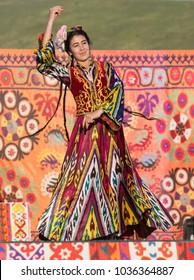 Surkhandarya region, Uzbekistan.May 13, 2017. A woman in a national costume shows a dance on stage.Folklore festival spring in Boysun, Uzbekistan