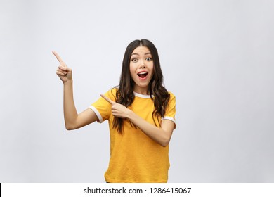 Surprise Asian Woman with finger point up isolate on white.