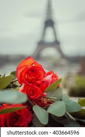Surprise engagement ring on the rose bouquet under the Eiffel Tower in Paris