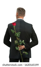 surprise. happy valentines day. male formal fashion. handsome man hide rose behind back. prepare surprise for romantic date. Black tie for formal events. tuxedo man with rose. secret valentine.