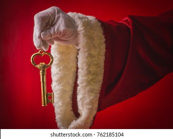 Surprise of Santa Claus a gold key from new house. Concept new dwelling.