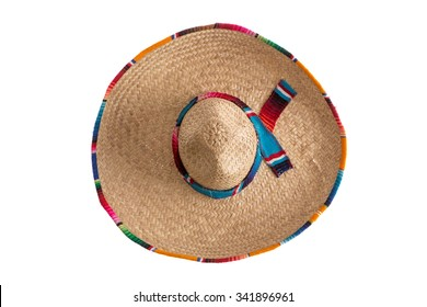 Surprise - what is hidden under the wide brim of the traditional sombrero hat, symbolic of Mexico, travel and tourism, overhead view isolated on white