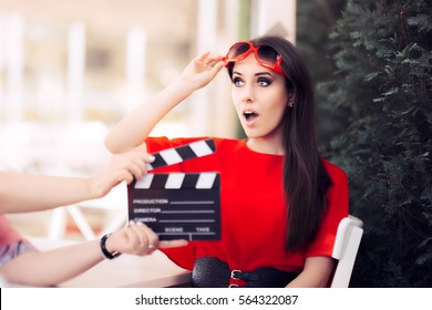 Surprised Actress with Oversized Sunglasses Shooting Movie Scene - Diva in red dress and big shades starring in an artistic film